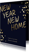Kerst-verhuiskaart met gouden spetters en typografie