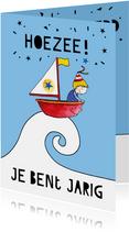 Verjaardagskaart jongen in bootje op zee