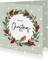 Kerstkaart stijlvol met kerstblaadjes en roodborstje