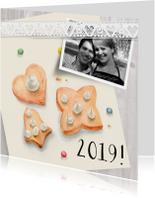 Nieuwjaarskaart met kerstkoekjes en foto