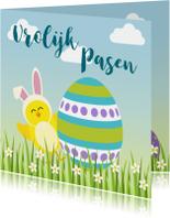 Paaskaarten - Paaskaart met vrolijk geel kuiken achter paasei