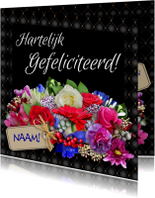 Verjaardagskaart met mooi kader en bos kleurige bloemen
