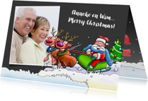 Leuke kerstkaart met rendieren en kerstman in slee