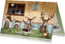 Nieuwjaarskaart met hertjes aan een gezellige tafel