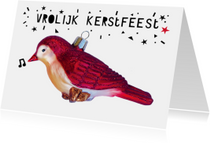 Vrolijke kerstkaart met vogel kerstbal