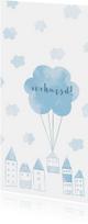 Verhuiskaart langwerpig  met huisjes en wolken