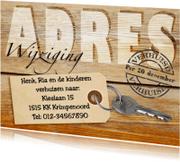 Verhuiskaarten - Adreswijziging met sleutel op hout