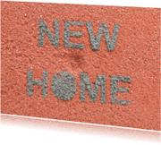 Verhuiskaarten - NEW HOME van cementletters op baksteen