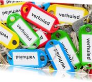 Verhuiskaarten - Stapel sleutels met labels met verhuisd