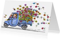 Vespa Ape met vele bloemen